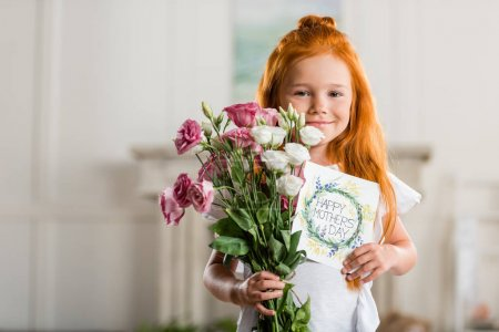 Photo for Portrait of adorable smiling girl holding bouquet of flowers and happy mothers day greeting card - Royalty Free Image