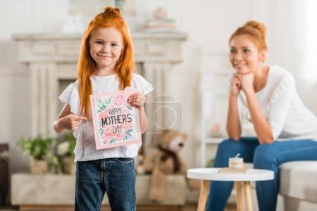 girl with happy mothers day postcard