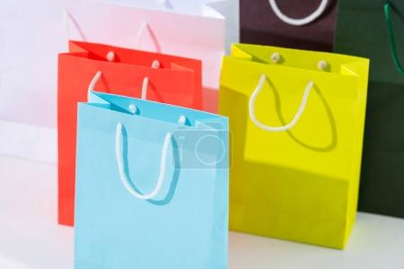 Photo for Close-up view of colorful paper bags isolated on white - Royalty Free Image