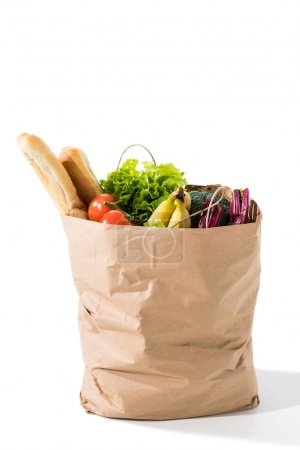 Photo pour Légumes frais, des baguettes et des bananes dans le sac d'épicerie isolé sur blanc - image libre de droit