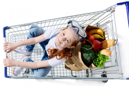redhead child with shopping trolley