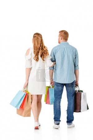 Couple holding shopping bags