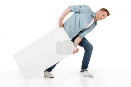 Photo for Young man dragging blank banner isolated on white - Royalty Free Image