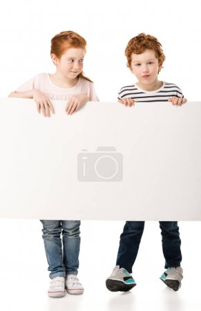 Photo for Cute little redhead children holding blank placard isolated on white - Royalty Free Image