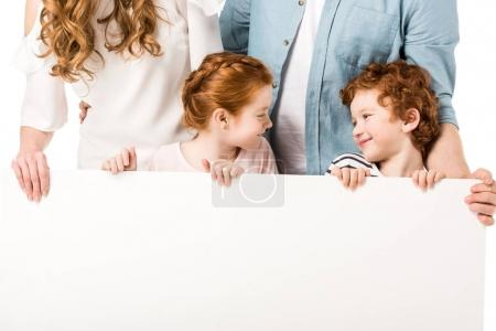happy family holding banner