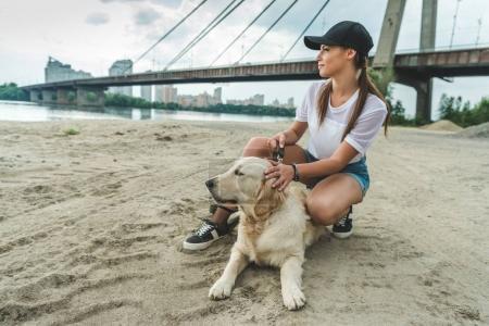 woman with dog on beach
