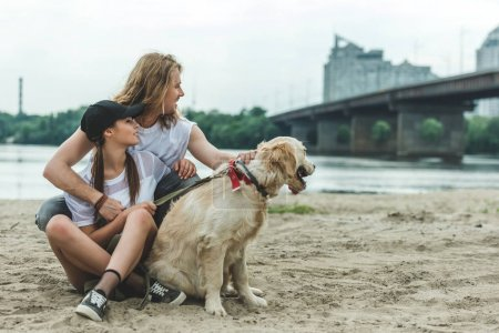 young couple with dog