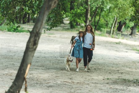 young couple on walk with dog