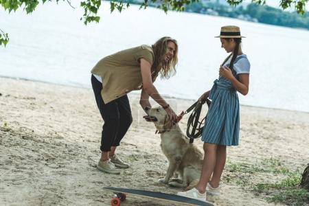 couple with dog on beach