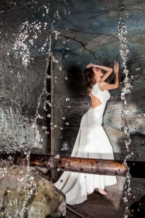 Sensual woman near waterfall