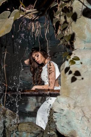 attractive woman near waterfall