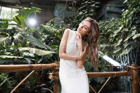 beautiful woman in tropical park