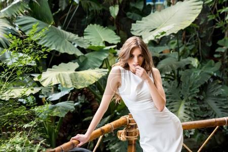 seductive woman in tropical park
