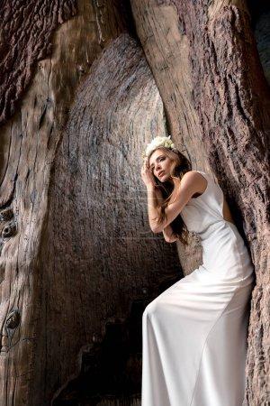 attractive bride in flower wreath