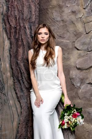 attractive bride with wedding bouquet