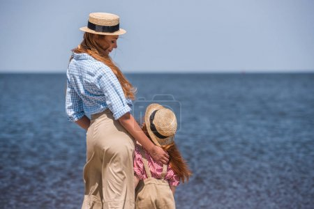 mother and daughter at seashore