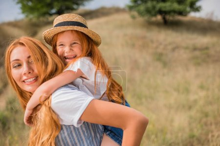 mother piggybacking daughter