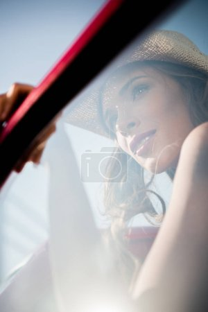 Woman behing car window