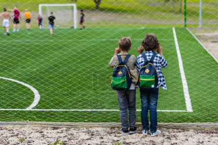 schoolboys on soccer field