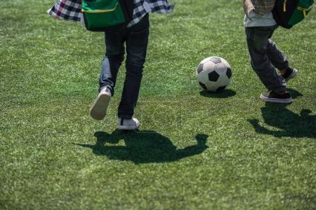 Schoolchildren playing soccer
