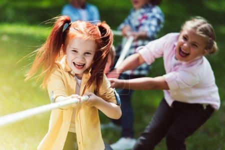 multiethnic kids pulling rope
