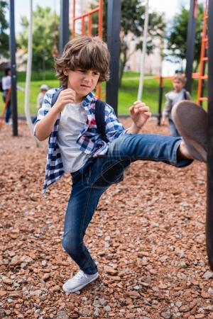 child hitting punching bag