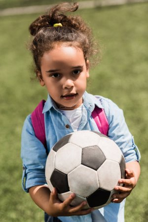 African american child with soccer ball