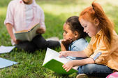 kids reading books in park