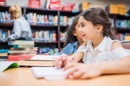 schoolgirls gossiping at library