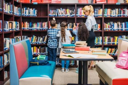 teacher with kids in library