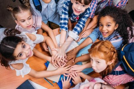 Photo for Top view of team of adorable kids making team gesture - Royalty Free Image