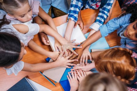 kids making team gesture