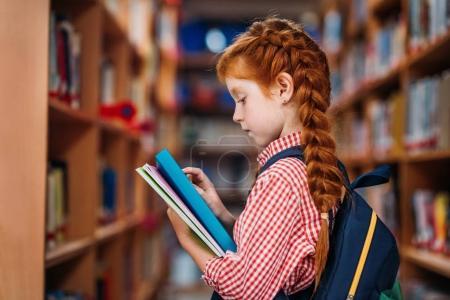 redhead schoolgirl in library