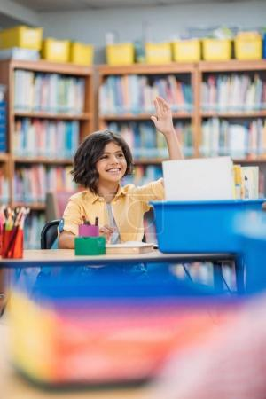 Girl raising hand on lesson
