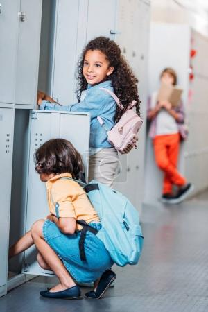 girls putting stuff in lockers