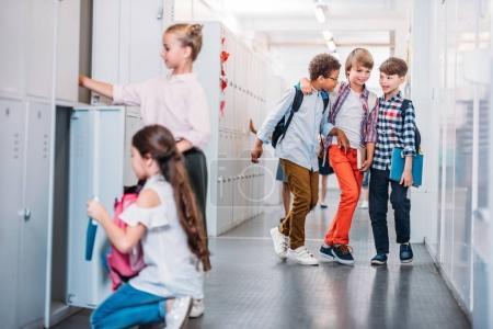 children in school corridor