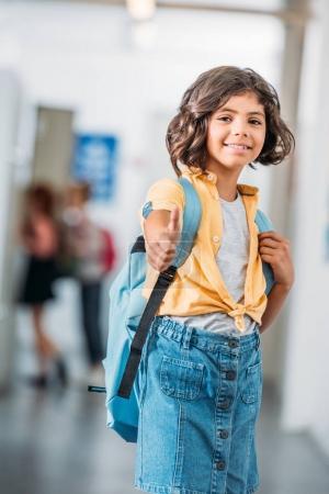schoolgirl showing thumb up