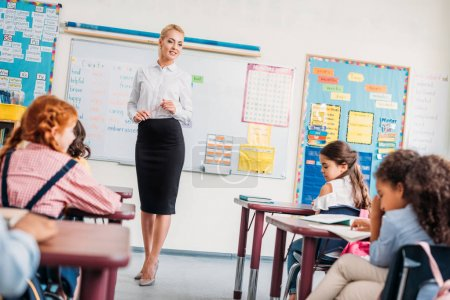 beautiful young teacher in class