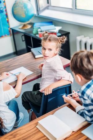 schoolgirl talking to classmate