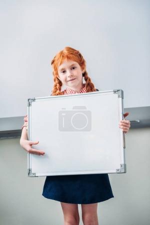 Schoolgirl with blank whiteboard