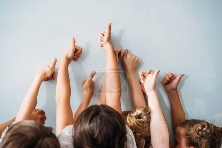 group of kids showing thumbs up