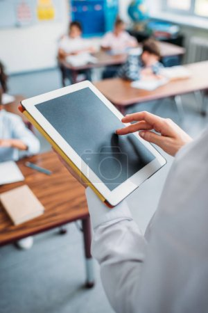 teacher using digital tablet