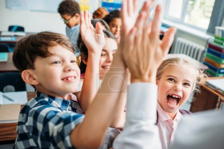 kids giving high five to teacher
