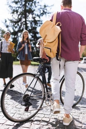 male student with bicycle