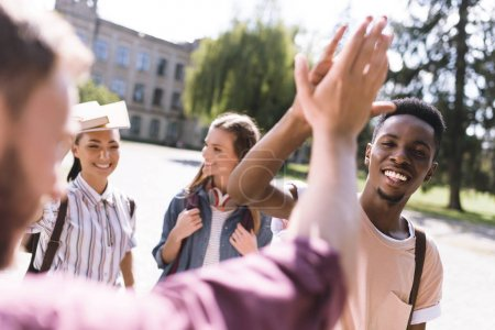 students giving highfive