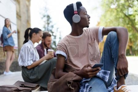 African american student in headphones