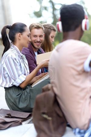 multiethnic students reading books