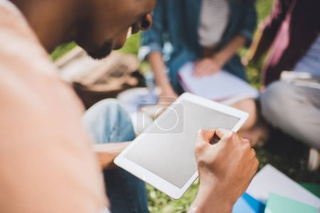 Photo for Close-up partial view of smiling african american man using digital tablet with blank screen - Royalty Free Image