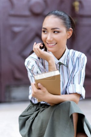 asian woman with book