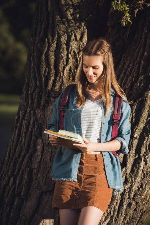 young girl with books in park